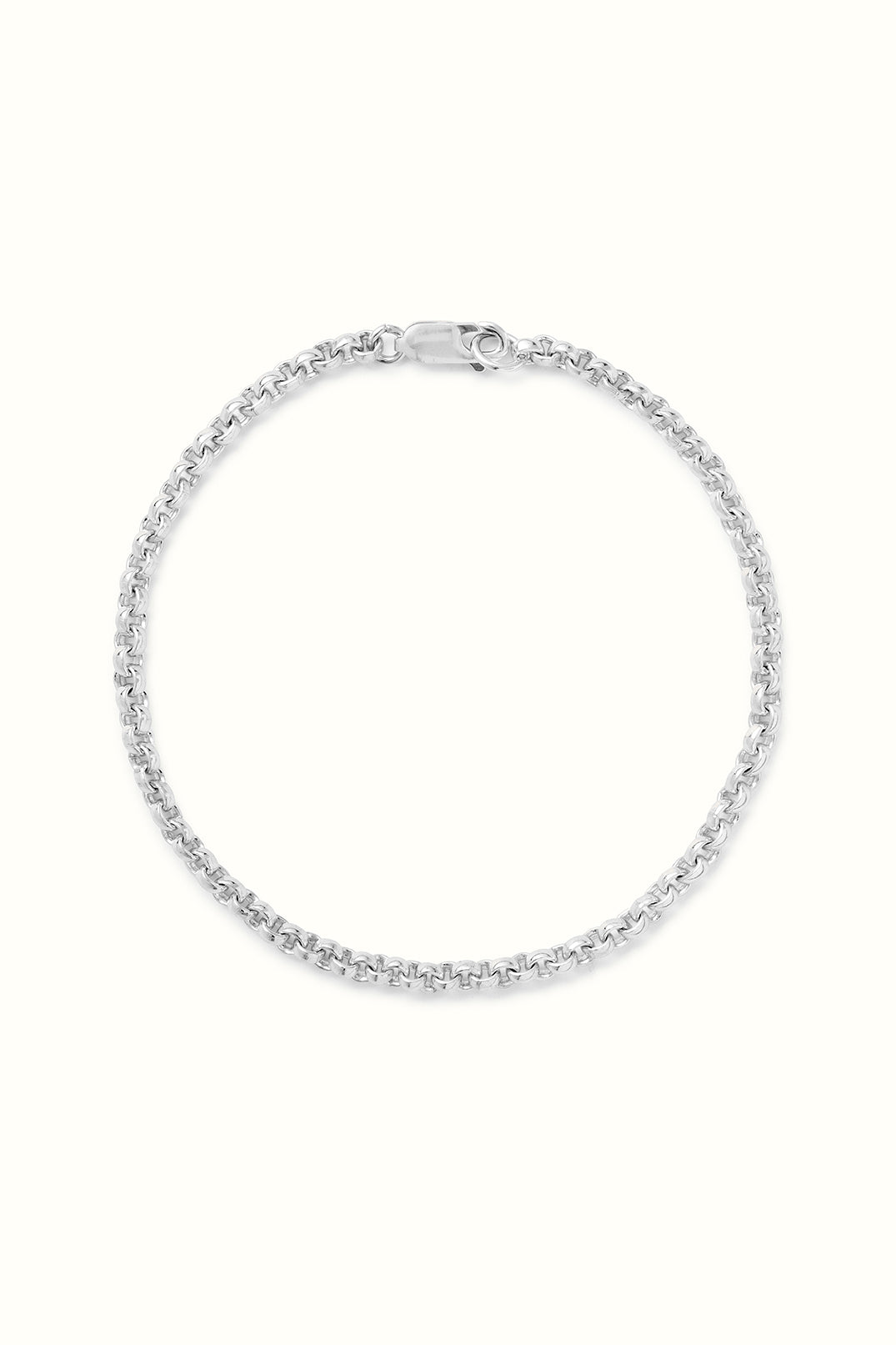 a product picture of a sterling silver rolo chain bracelet on a white surface