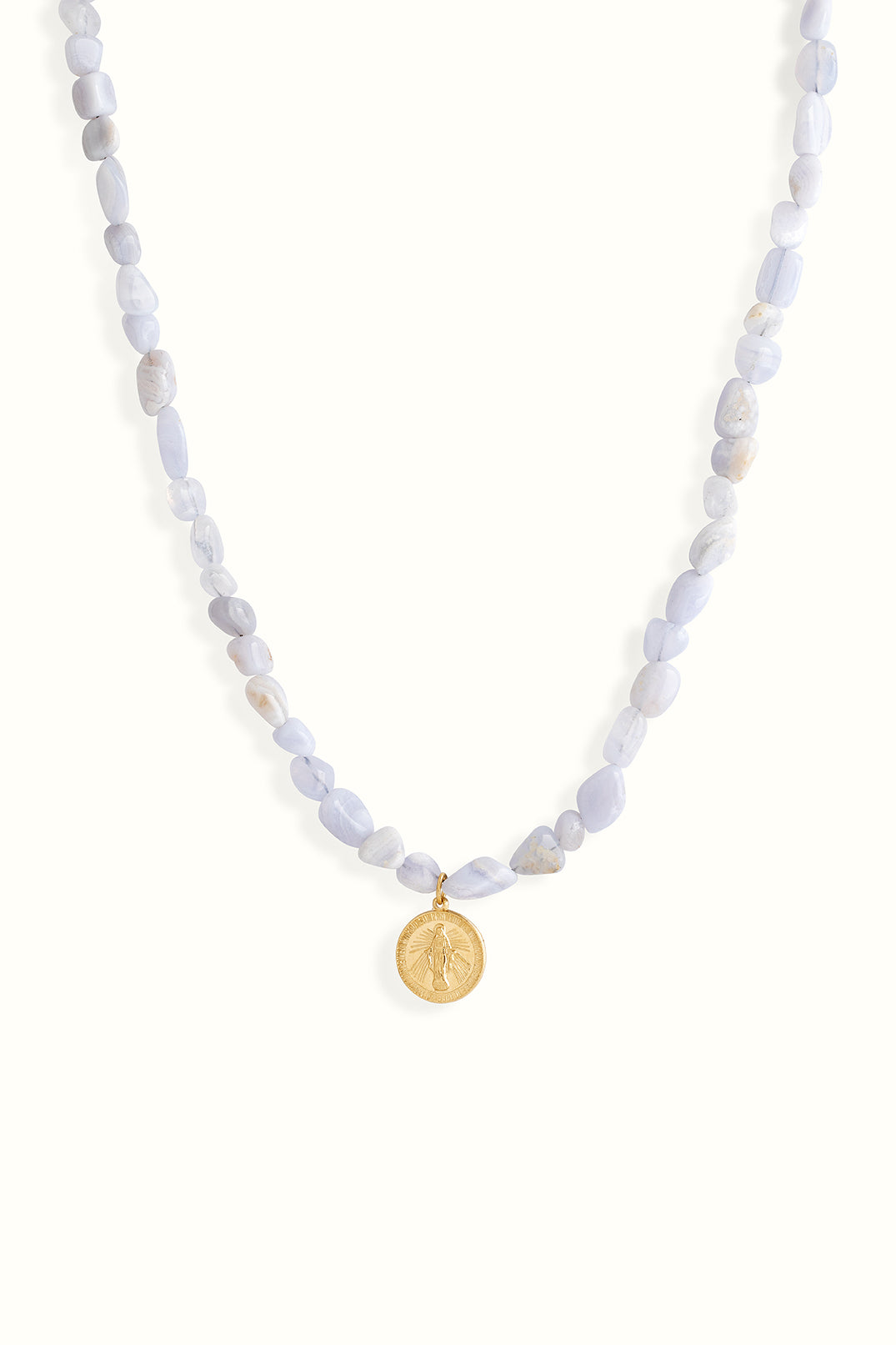 a product picture of a blue lace gemstone beaded necklace with a gold filled round mary pendant on a white background