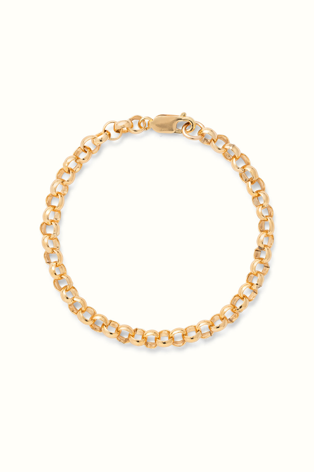 a chunky gold filled rolo chain bracelet lying on a white surface