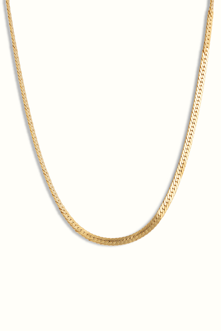 a chunky gold filled herringbone necklace on a white background