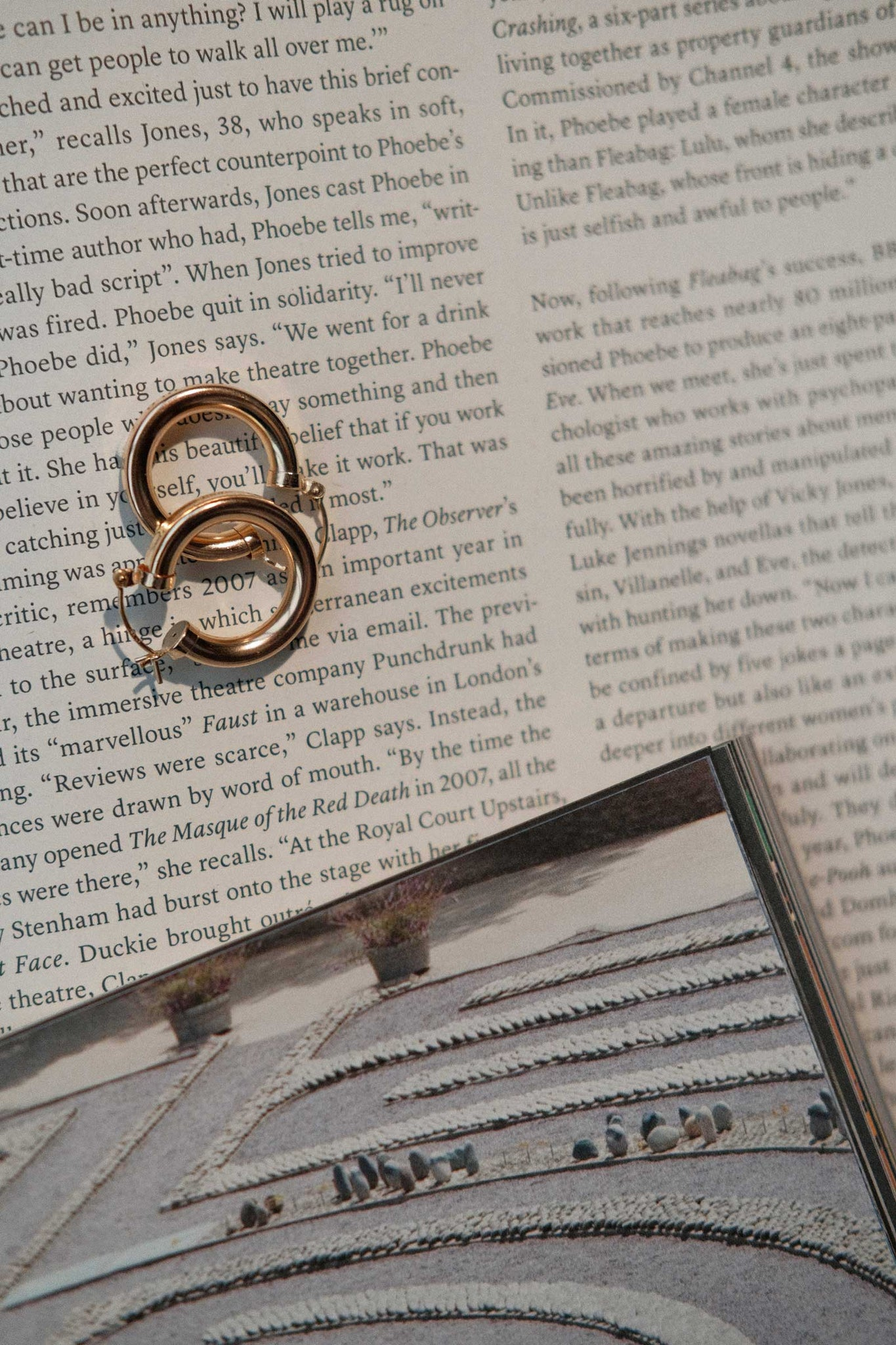 set of chunky hoop gold filled earrings lying on a newspaper