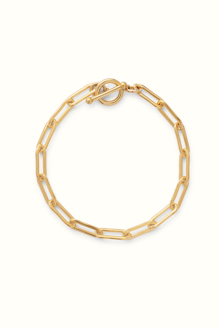 a gold filled chunky paperclip chain bracelet with a toggle clasp on a white background