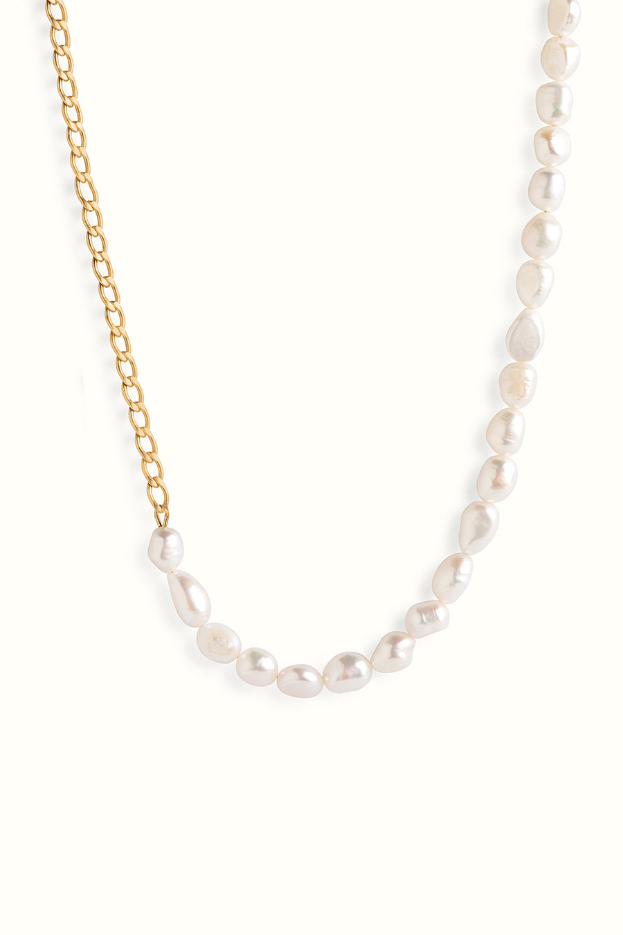 a necklace that is made of half gold filled curb chain and half fresh water pearls