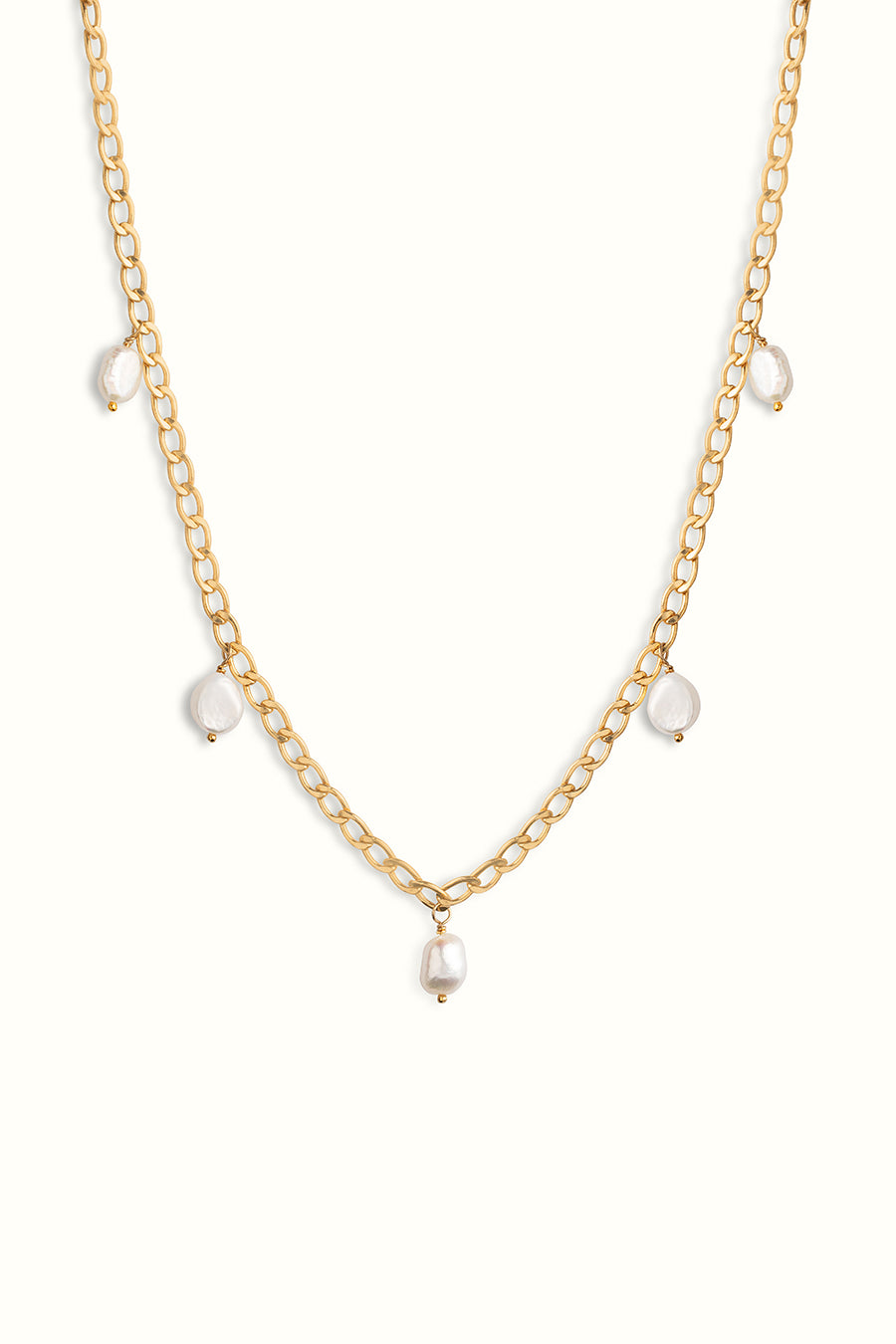 gold filled curb chain necklace with multiple pearl drops on a white background