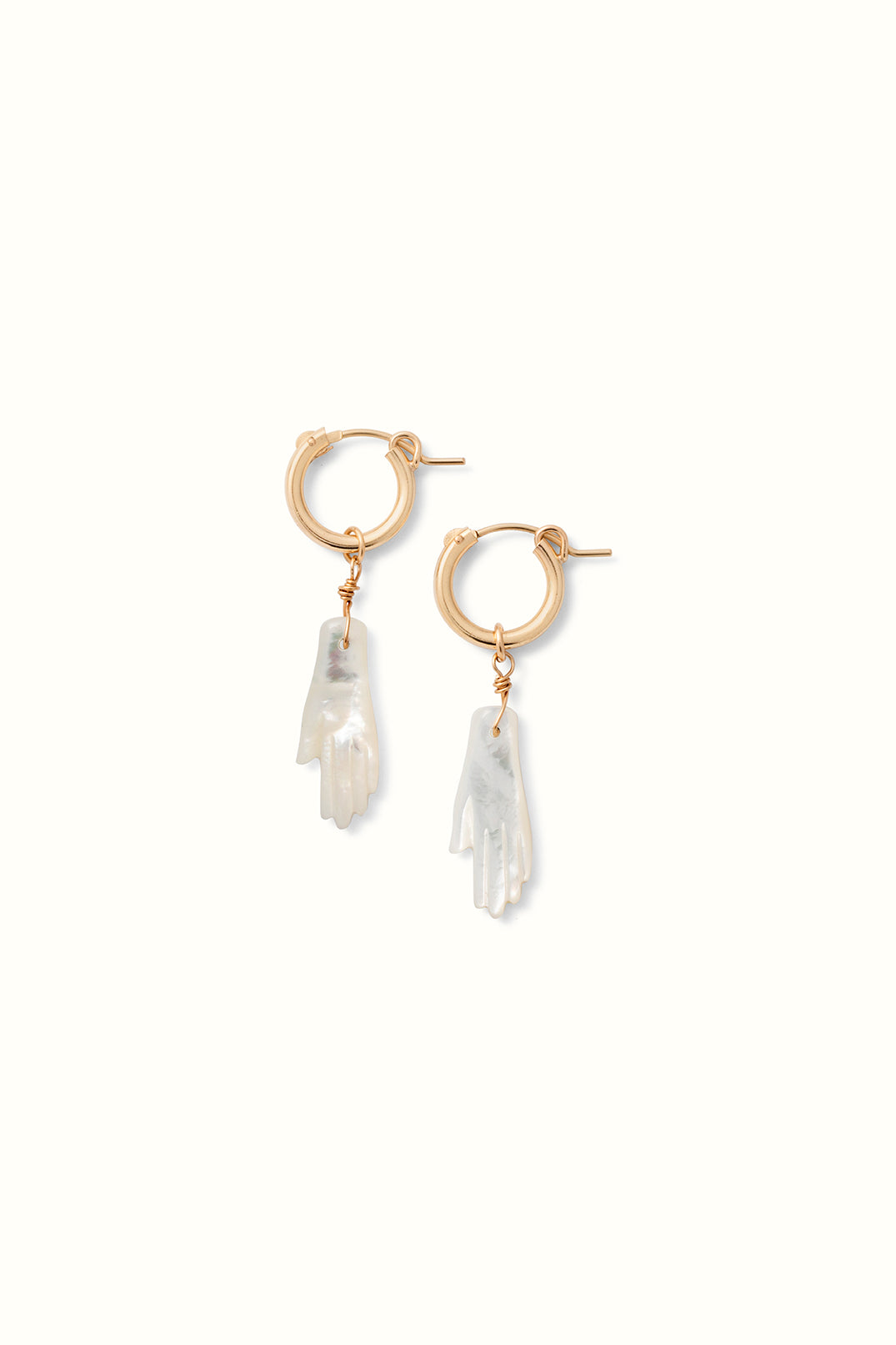product close up picture of a set of gold filled hoop earrings with a mother of pearl hand shaped bead pendant