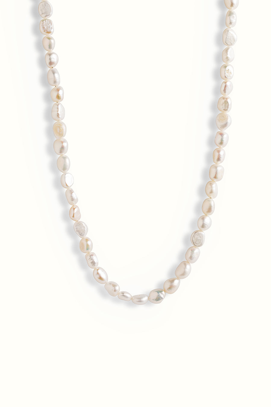 a fresh water pearl necklace on a white background