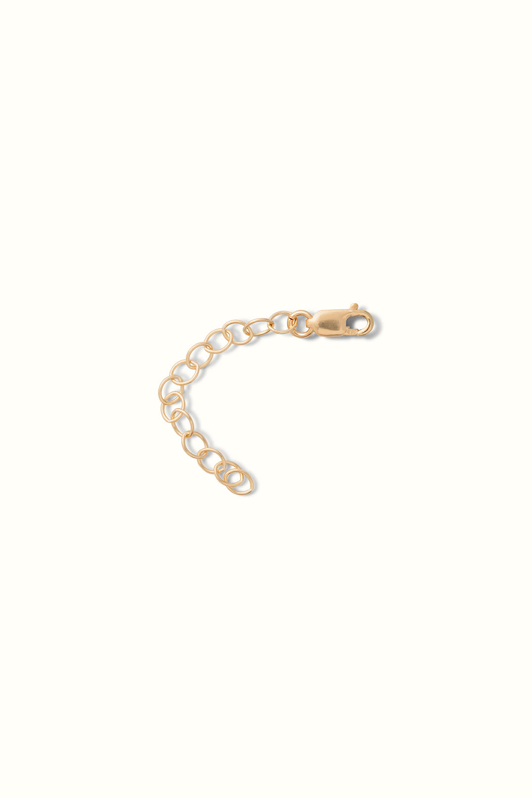 a close up of a gold filled necklace and bracelet extender chain on a white background