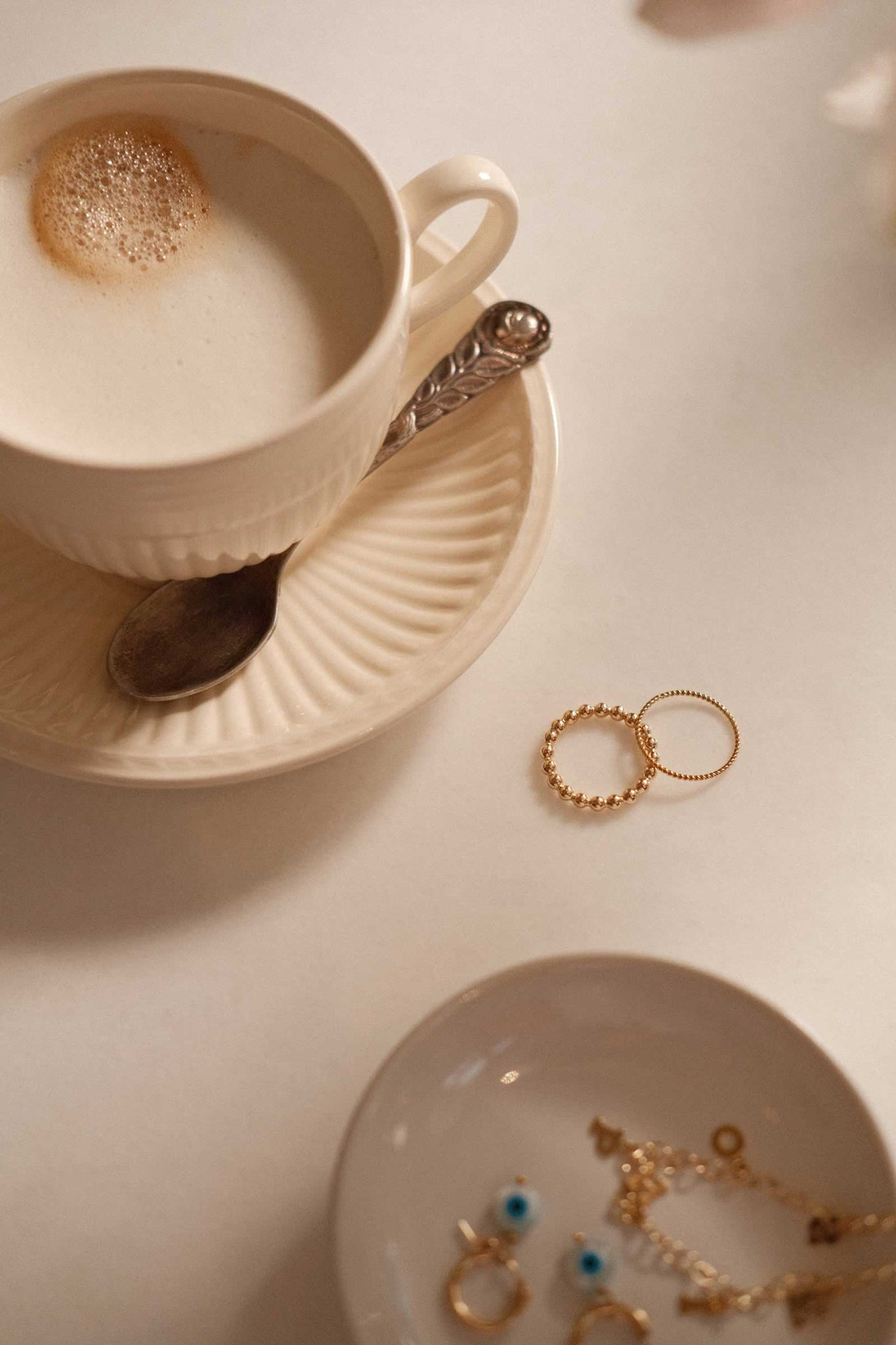 a set of gold filled finger rings lying on the kitchen table