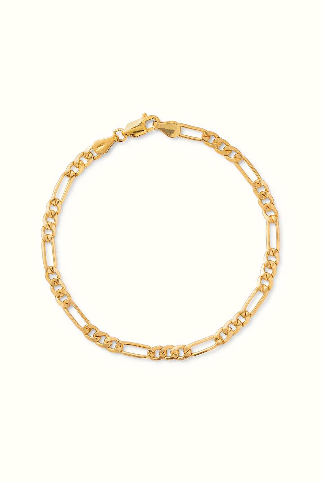 a product picture of a chunky gold filled figaro chain bracelet lying on a white surface