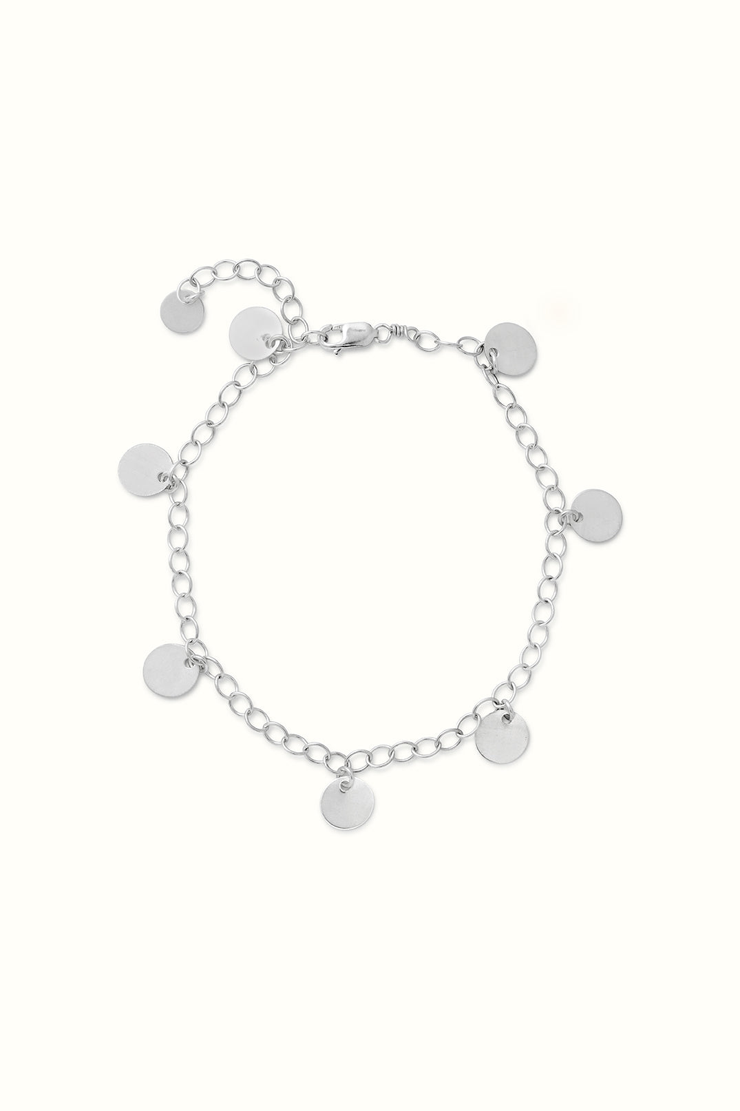 a sterling silver round charm bracelet lying on a white surface