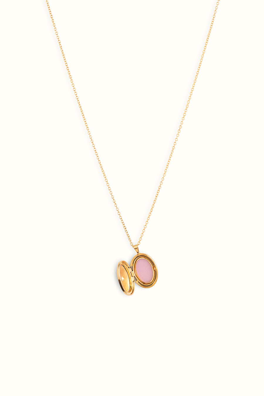 a golf filled necklace with a golden opened locket pendant on a white background