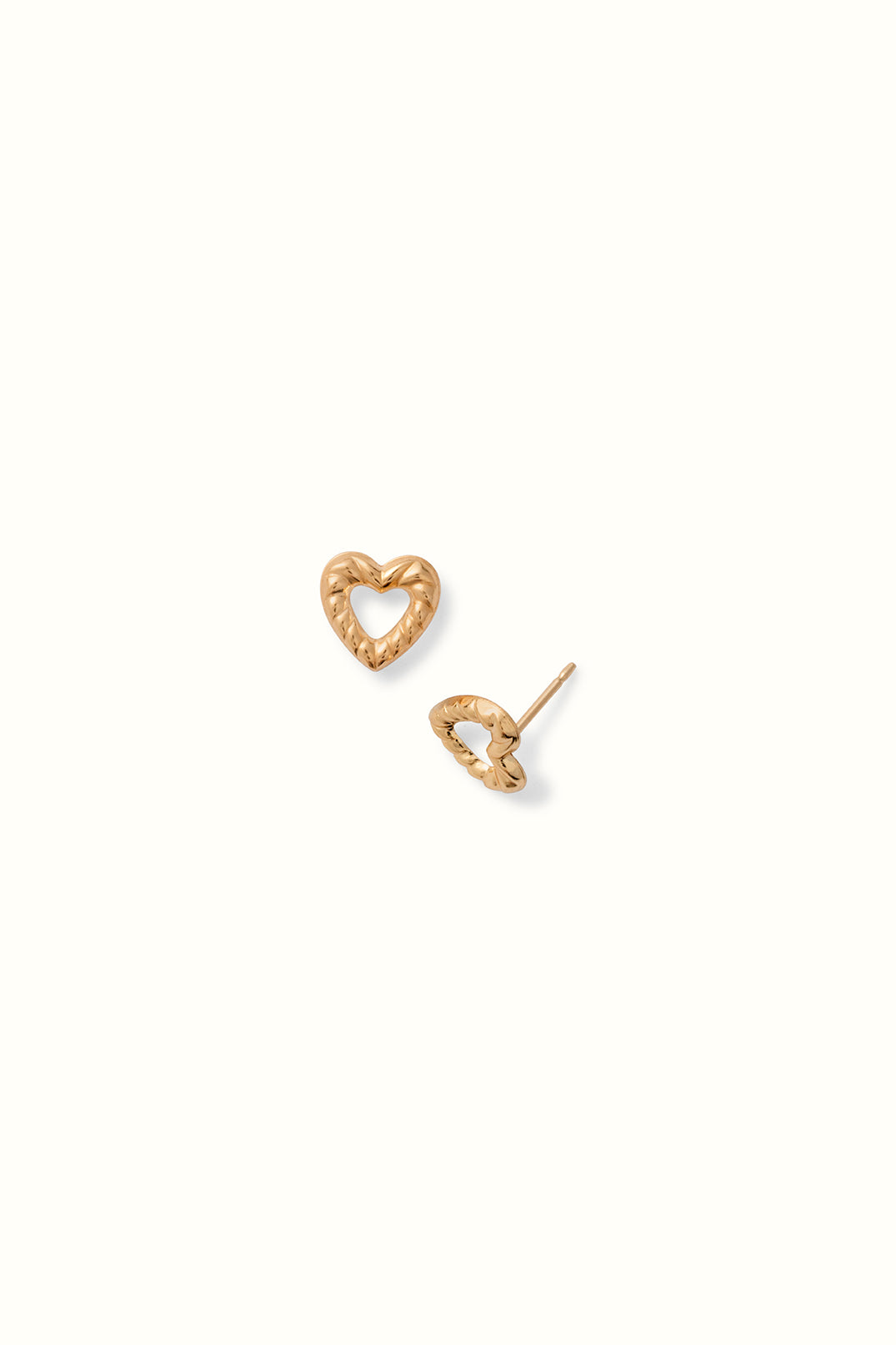 a pair of ribbed open heart stud earrings on a white background