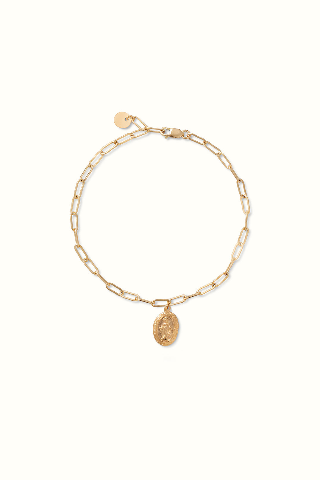 product shot of a gold filled paperclip bracelet with a mary charm