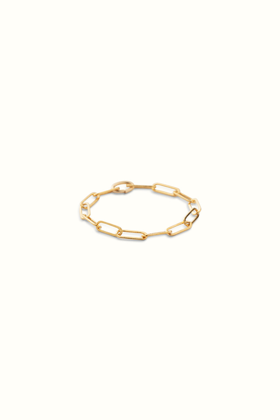 a slim gold filled paperclip chain ring on a white background