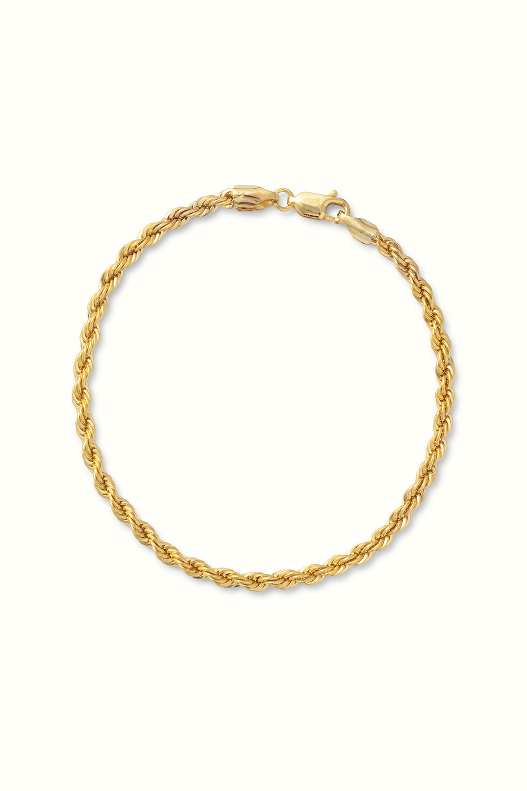 gold filled rope chain bracelet on a white surface