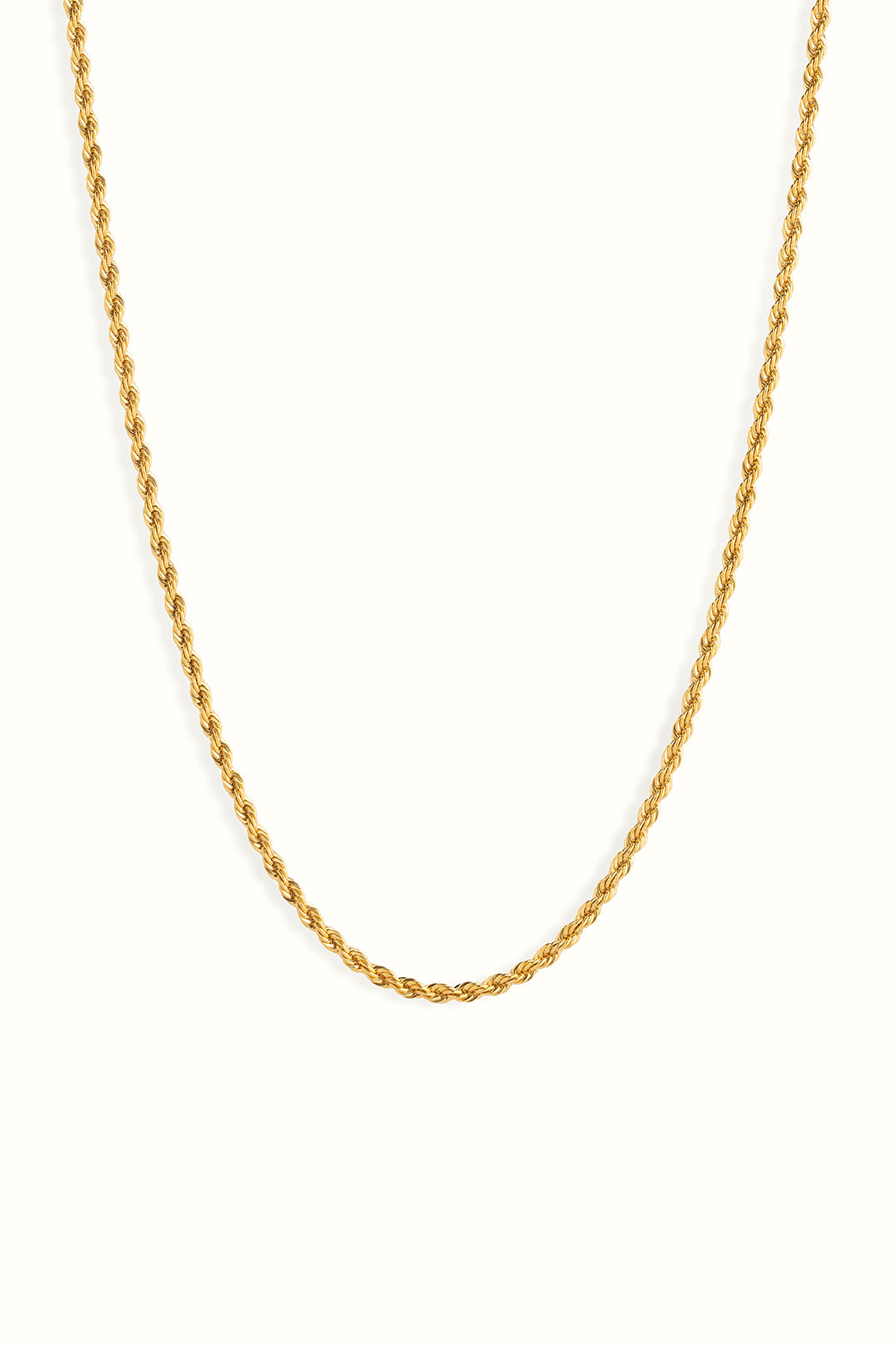 chunky gold filled rope chain necklace in front of a white background