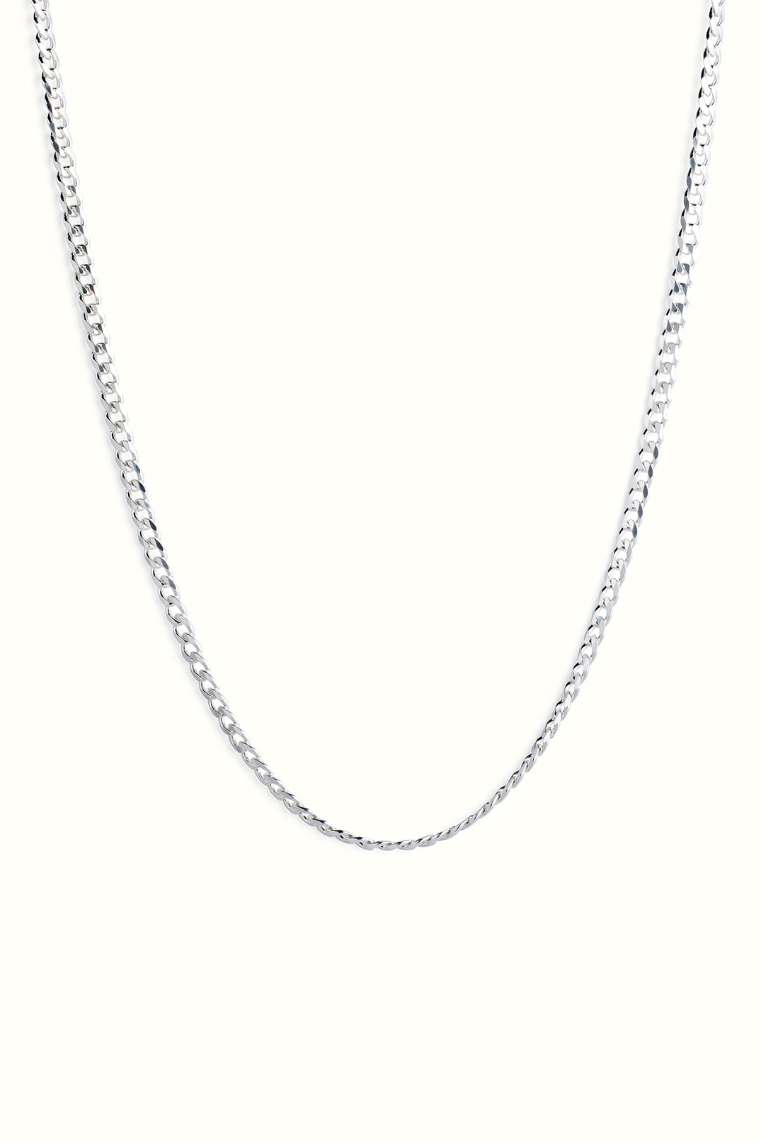 chunky sterling silver diamond cut curb chain necklace in front of a white background