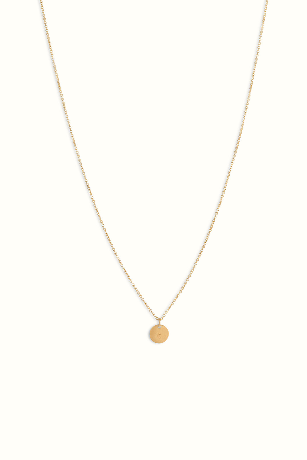 gold filled round cable necklace with a round disc style initial pendant