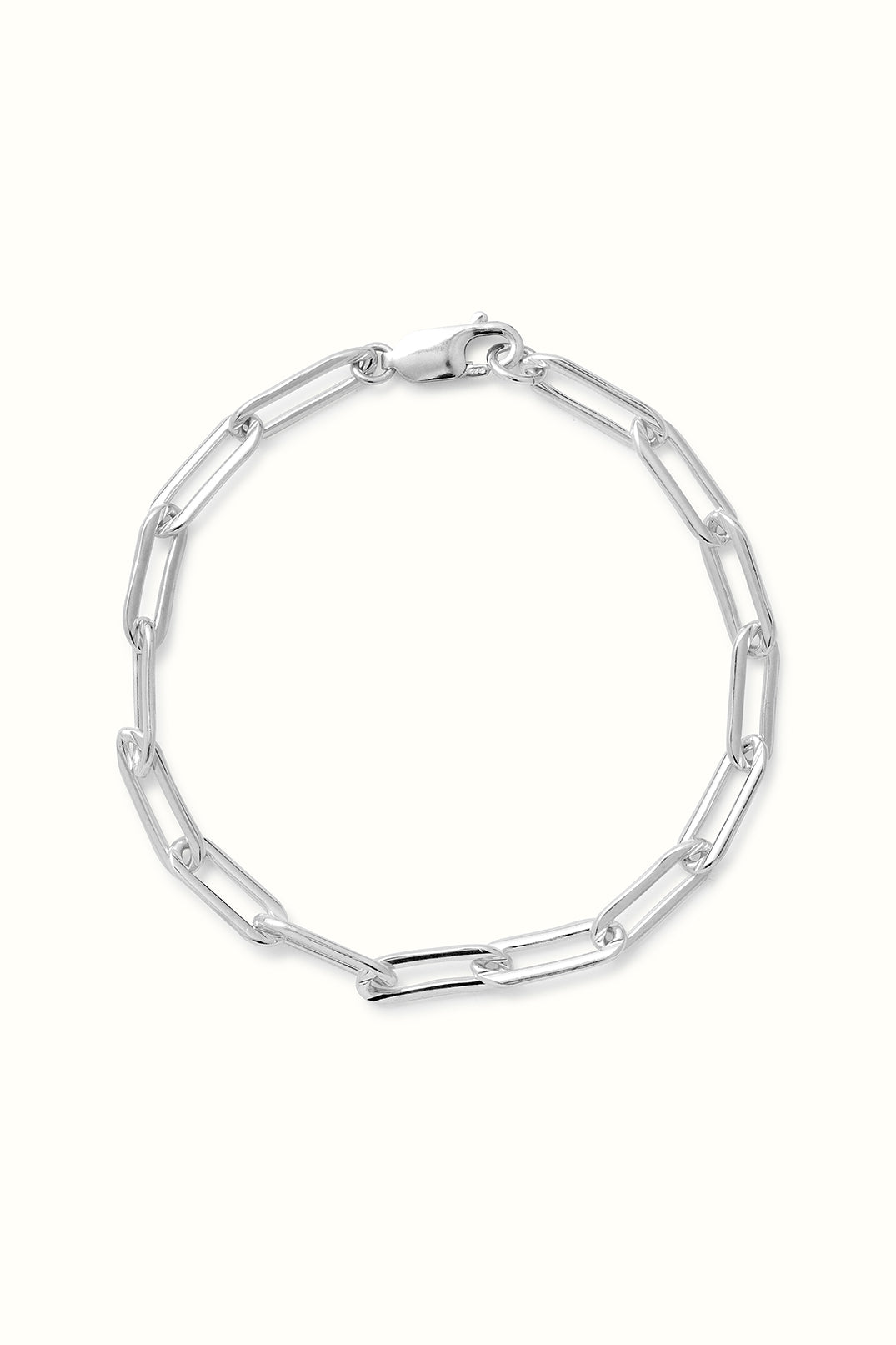 a product close up of a silver chunky paperclip chain bracelet on a white surface