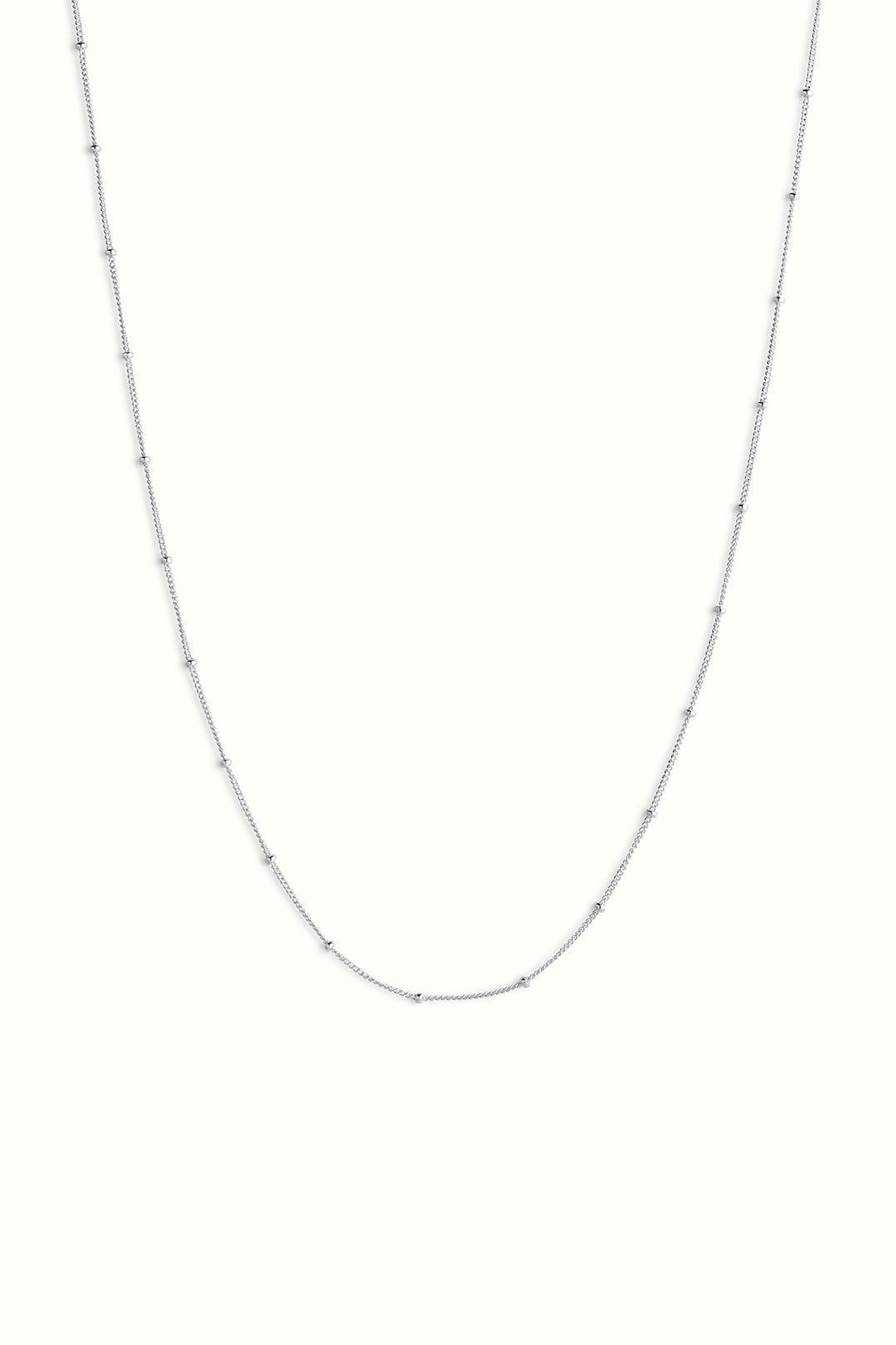 sterling silver saturn chain necklace on a white background