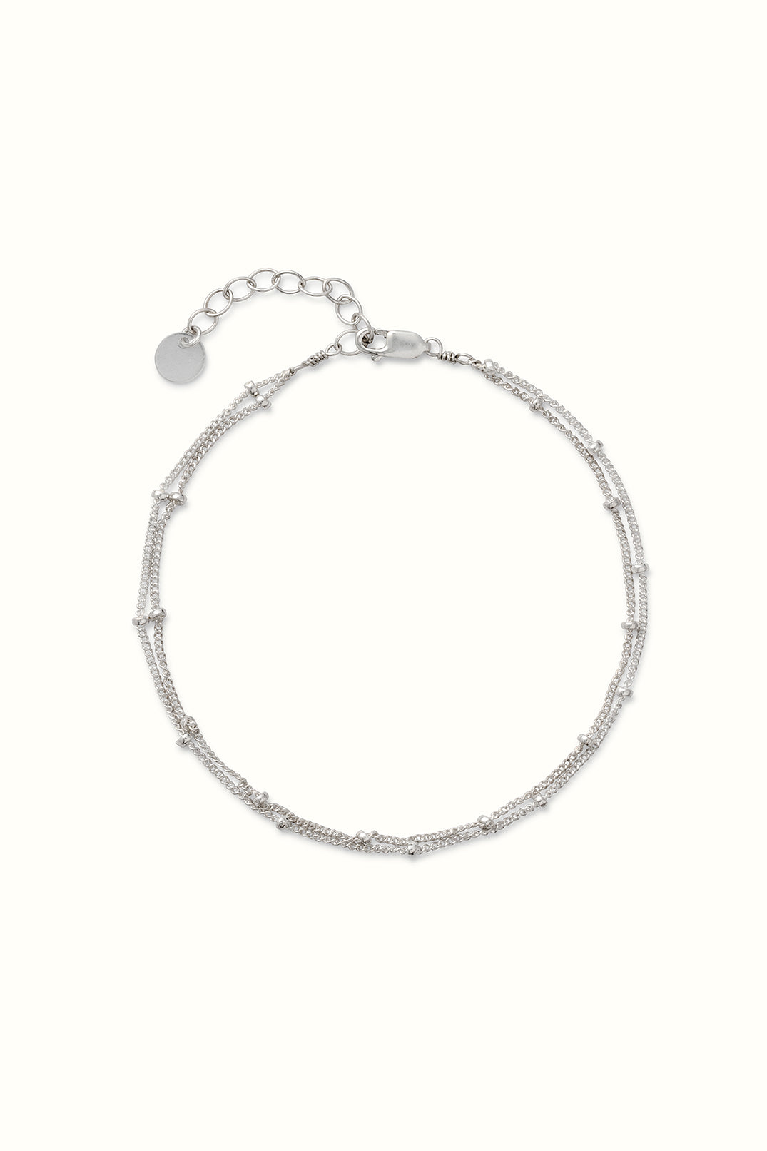 product picture of a silver saturn chain bracelet on a white surface