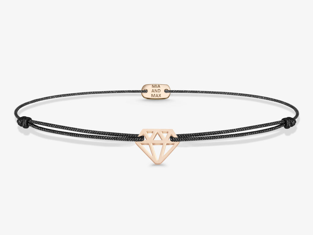 The diamond bracelet features a cute diamond shaped sterling silver pendant and strong textile cord. It comes in rose gold or silver color.