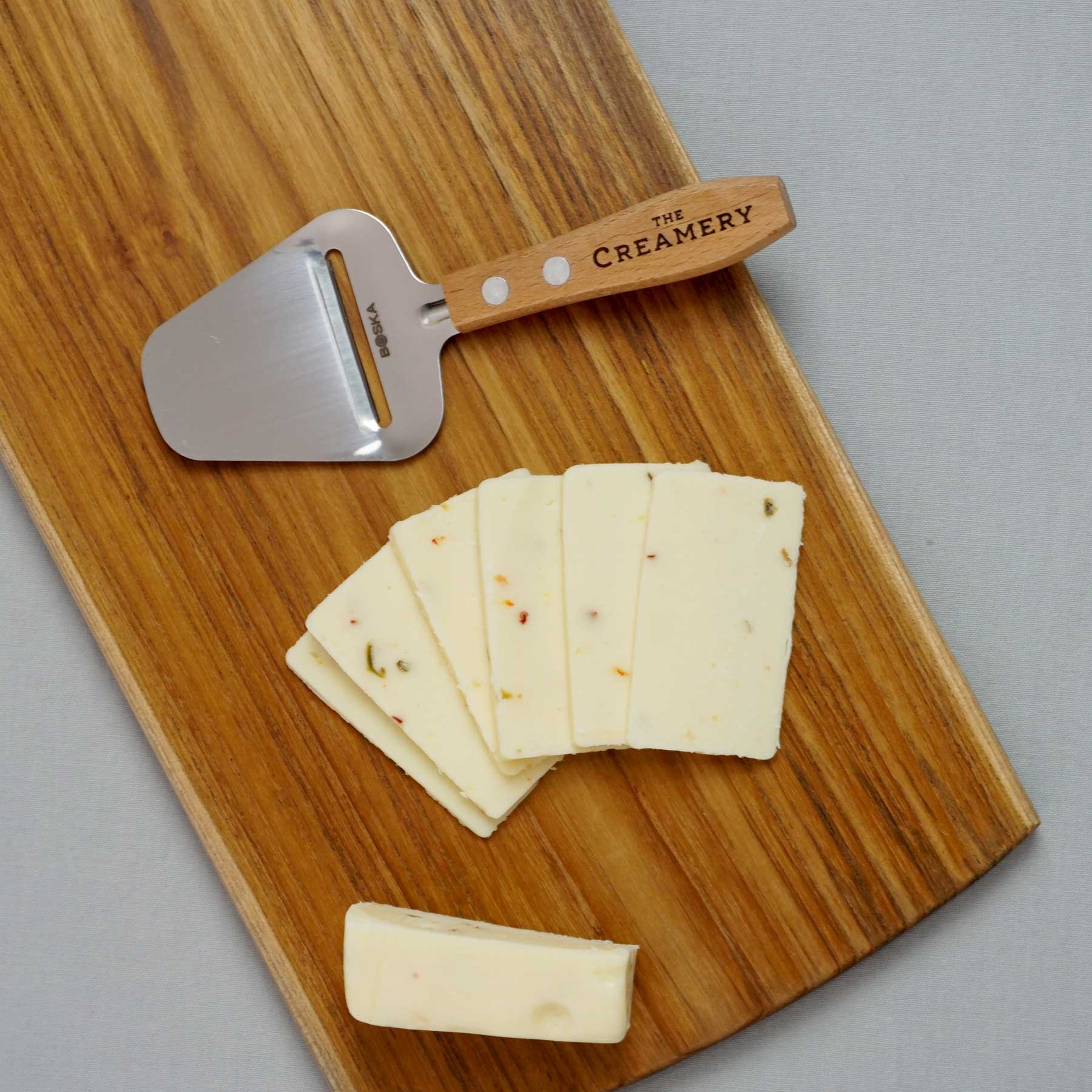 image of The Creamery Mini Wooden Cheese Planer with cheese