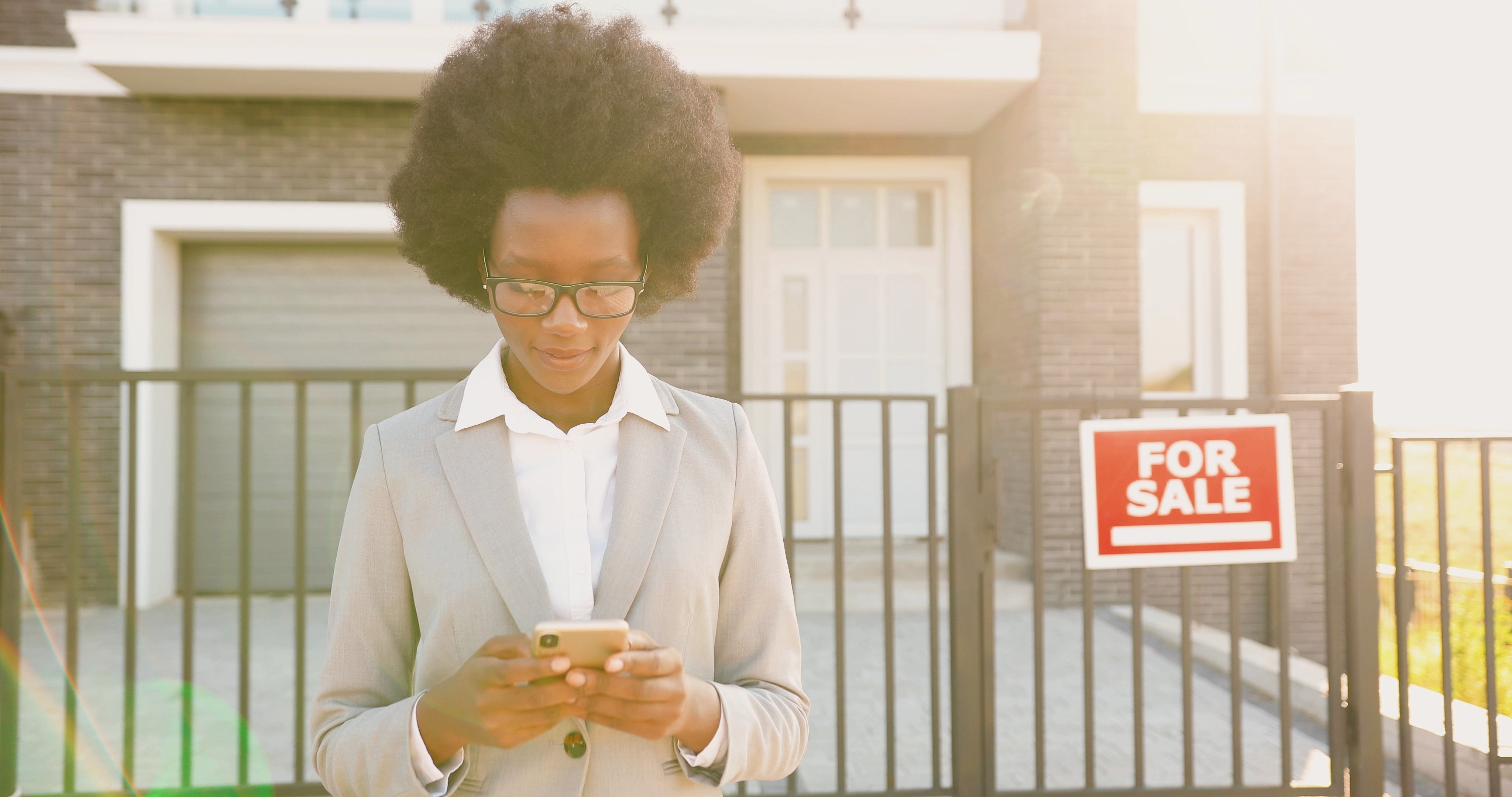 Real Estate Agent Woman on Cell Phone Choosing the best apps for you