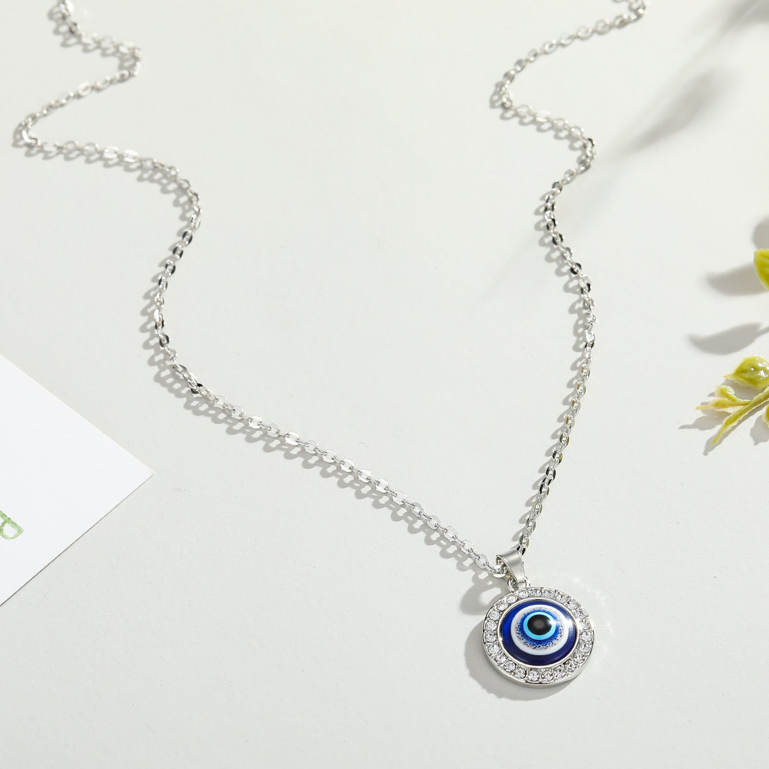 "<img src=""necklace.png"" alt=""evil eye necklace 18k silver plated nickel free lead free"">"
