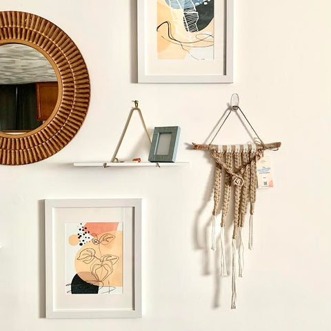 Gallery Wall with Mirror, Shelf, Two Art Prints, and a Macramé Wall Hanging