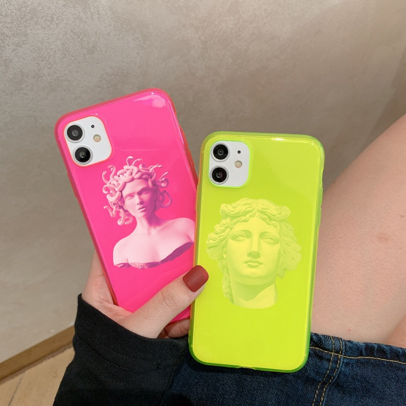 Picture of both cases. The first is the neon pink case with a picture of a medusa statue. The second is a neon green case with a picture of a michelangelo statue.
