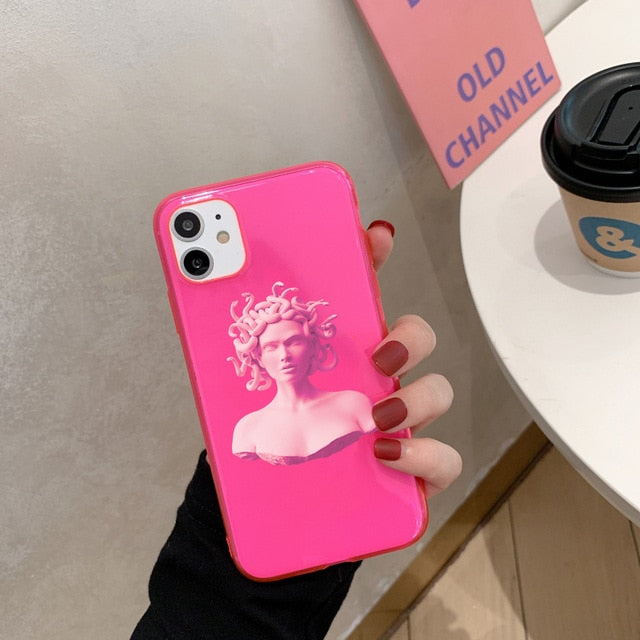 Showcases the neon pink medusa printed iphone case.