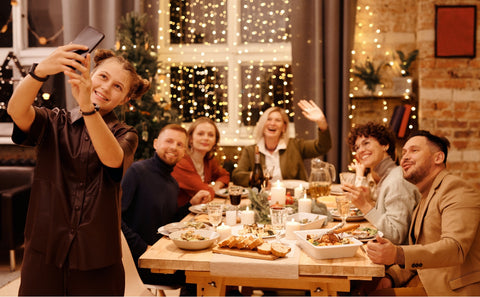 People celebrating, having dinner on a dining table