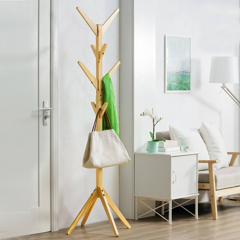 A solid wooden hanger with 8 hooks fixed to the floor for hanging clothes and jacket