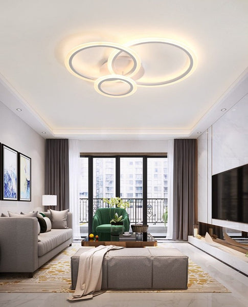 Lights of Scandinavia - Olympia - Modern simple white LED ceiling light. Fits most rooms and creates a harmonic atmosphere with the possibility to change lighting features with remote control Aluminum body and frame, acrylic LED covers.   Application: Living room, Bedroom, Hall, Lobby, Hallway, Aisle, Balcony etc.     Olympia comes in 3 different sizes:  Single circle - D40cm, 5-8m2  Two circles - D30cm x D50cm, 8-12m2  Three circles - D20cm x D30cm x D40cm, 12-18m2 D30cm x D40cm x D50cm, 18-22m2 D40cm x D50cm x D60cm  Height: 12cm