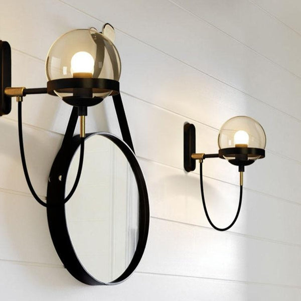 Lights of Scandinavia - Höskulle - Postmodern lighting. Wall-mounted E27 fixture. Works just as good in the bedroom as in corridors, hallways and the conservatory.  Iron fixture with two different glass variations to choose from.   Specifications    Shipping      Why Us?