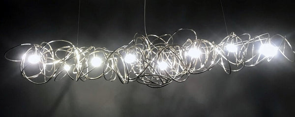 Lights of Scandinavia - Ball of Yarn - Breathtaking art deco lighting.  Bent aluminum framework in 4 color variants, equipped with multiple E17 light sources. This chandelier will make the most of your living room area, add style to a conference room or act as the perfect icebreaker for the reception.   Each Ball of Yarn is handmade so allow for slight differences between the photos and your finished product.