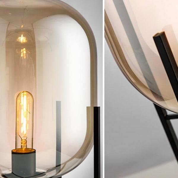 """Lights of scandinavia - Fyr - Modern table/floor lighting with E27 fixture. Works just as good in the bedroom as in corridors, hallways or as spot lighting in a living area. Fun fact: """"Fyr"""" means lighthouse in Swedish.  Iron framework with two glass colors to choose from."""