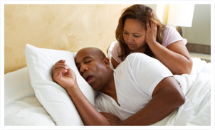 woman bother by husband's snoring