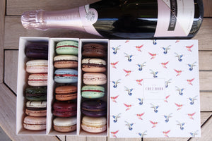18-piece macaron selection and a bottle of Kreinbacher's Nature Brut sparkling wine
