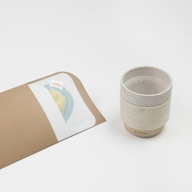 The Take It Easy Tumbler and the Original Heat Pack inside it's envelope packaging.