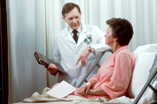 doctor seeing his patient in his clinic
