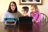 Mom and two children with two Tobii Dynavox Devices