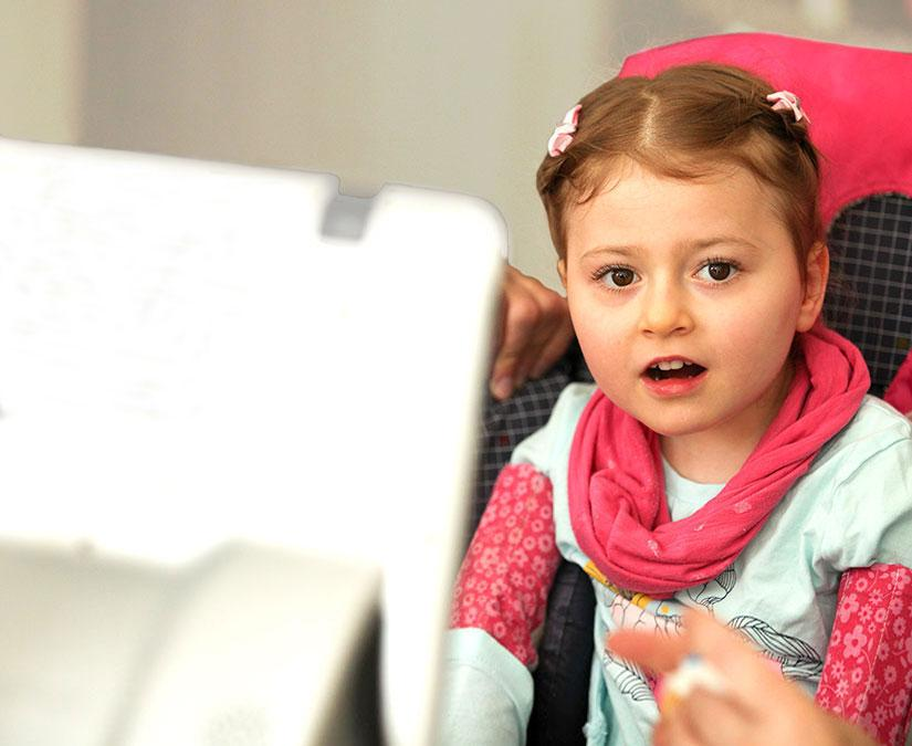 Child using her Tobii Dynavox device