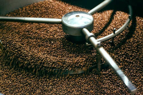 Beans being roasted in a roasting machine