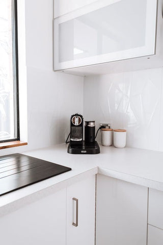 A simple coffee machine on a kitchen counter
