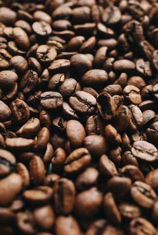 Close up of many dark roasted coffee beans