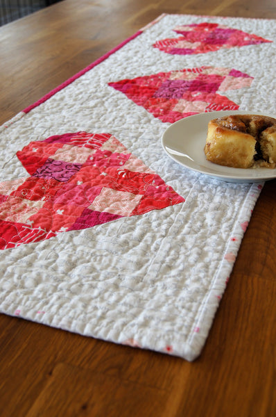 Tumbled Love Table Runner Pattern by Monika Henry of Penny Spool Quilts - scrappy hearts quilted table runner