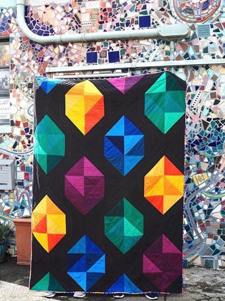 Facets modern gemstone quilt pattern by Monika Henry of Penny Spool Quilts - Quilt featuring modern, simplified gemstones in a variety of colours on black background