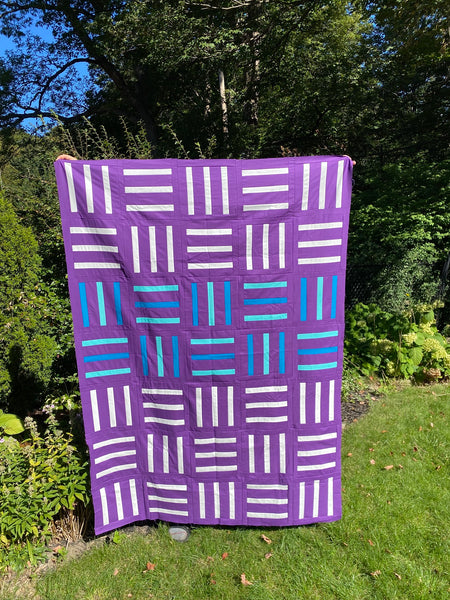 Bar Code Quilt pattern by Monika Henry of Penny Spool Quilts - tester quilt by Heather Quinn in purple, white and blue